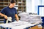 Asendia women sorting e-paq